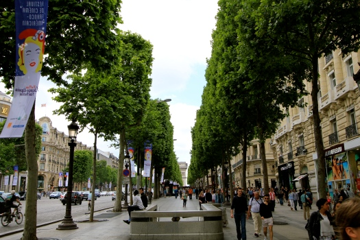 Strolling down the Champs Elysees from the Arc de Triomphe to the Louvre Museum