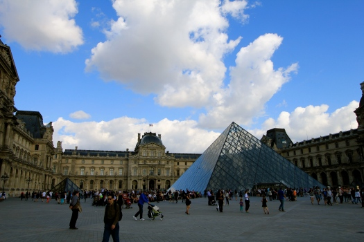 A beautiful day for a walk outside of the Louvre Museum