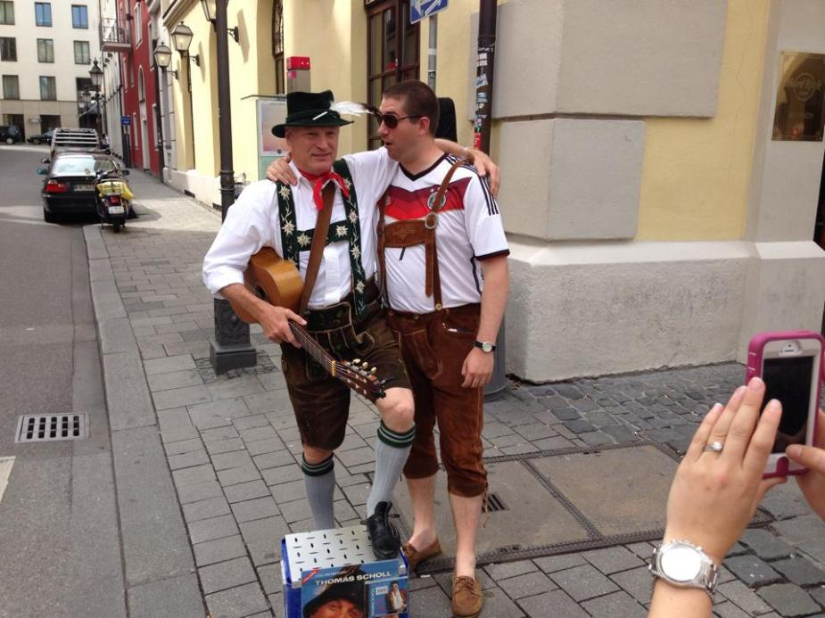 My friend Eric on the right enjoying a song with a street performer