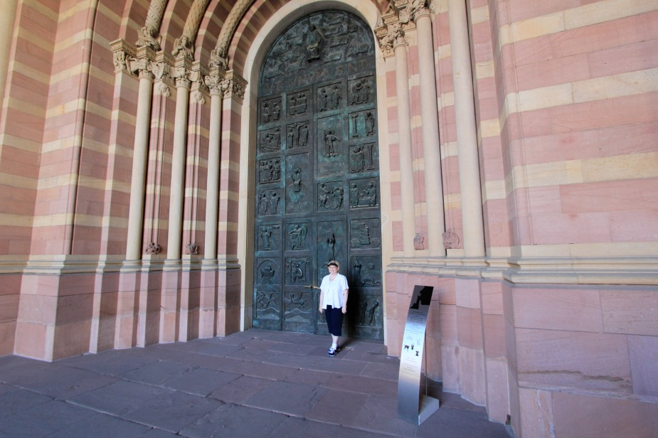 From a distance, it is hard to get a sense of how large the church is until you get closer....here my Mom is standing in front of the door to the church