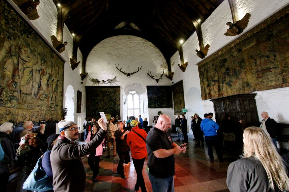 Inside Bunratty Castle. This is the center meeting hall. A fire would have been created in the center of the floor and the smoke would escape straight up through a hole in the ceiling.