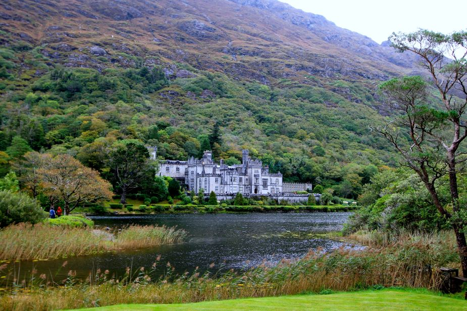 To be honest, I had not seen any pictures of the Kylemore Abbey, so I did not know what to expect when we arrived.   From the road, one would have no clue that this place even exists since it is in such a remote location. Originally, this was built as a home by a wealthy doctor Mitchell Henry from London who's family became wealthy in textile manufaturing. He and his wife Marget lived here in the late 1800s.