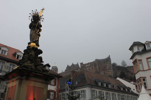 The Statue of the Virgin Mary in the foreground and the castle in the background
