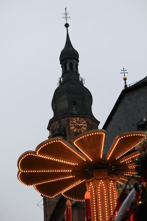 The iconic Germany Christmas Pyramid & the spire of the Church of St. Peter's Church in the background (this church building was built in 1398)