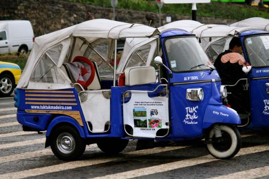 """A common taxi in Madeira....modified 3-wheeled motorcycles with a cover....they are called """"Tuk Tuks"""""""