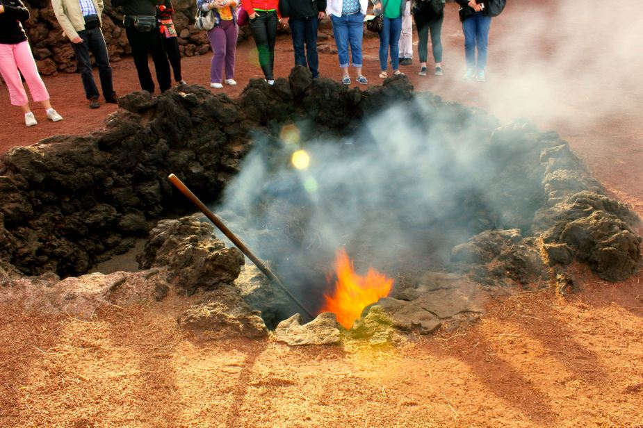 Digging a little deeper, the temperatures quickly rise. Here the demonstration is placing straw into a pit that is about 2 feet deep. As soon as the straw is placed down there, it catches on fire. Also, to demonstrate the heat, there is a pipe that is dug into the ground where water was poured down it, and 3 seconds later a geyser of steam erupted 20 feet into the air. I do not have a picture of this, but do have the video which I will post later.