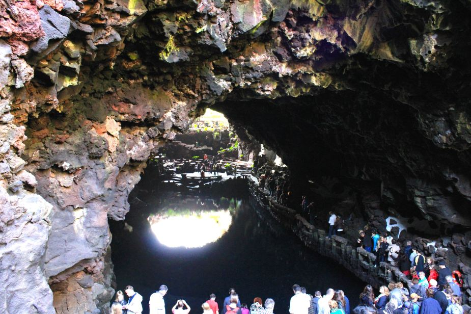 After leaving the Mirador del Rio overlook, we then went to the northeast part of the island to very unique place. It is an actual lava tube (tunnel) created as the lava flowed from the volcanoes to the sea. This area is called the Jameos del Aqua.   So, we enter down into the opening of the lava tube and there is this small, clear lake within the tunnel