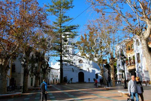 Courtyard at the Balcony of Europe with the Church of El Salvador in the background and Christmas decorations in the trees...can only imagine how beautiful it is at night
