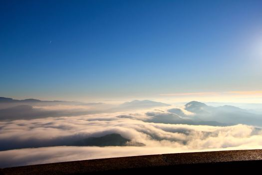 Then, at the top, it looks as it we are floating on clouds with the fog below.