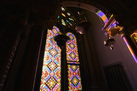 Beautiful stain glass windows and with the bright sun shining in, the room was full of colors as if you were standing inside of a prism