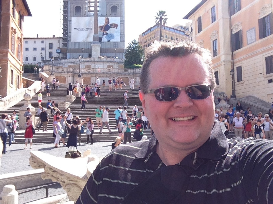 At the bottom of the Spanish Steps. Our last visit to Rome was in mid April 2013, and the temperature was about 10 degrees Fahrenheit warmer this time. It is early morning (10am is early in Rome), so the Steps are not crowded. But, by late afternoon, hundreds of people will be here sitting on the steps people watching.