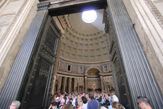 Entering the Pantheon through very large doors, you see the dome structure with the hole, which lets the sunlight inside. From my viewpoint as an engineer, this is the largest unsupported (no arches or beams) concrete dome structure in the world, which is a feat considering it was built 2000+ years ago. BTW, the hole is there so people can look up to God and so God can look down to the people.