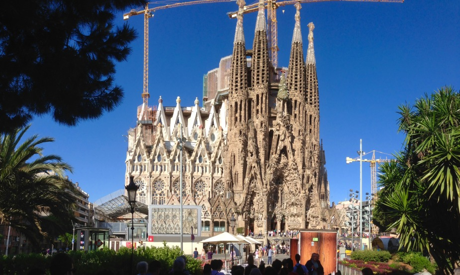 So...most really large cathedrals in Europe are very old and built centuries ago. This one, the Basilica of the Holy Family (Sagrada Familia in Spanish) is still under construction. Started in 1882 and designed by the famous architect Antoni Gaudi, Gaudi oversaw construction until his death in 1926, when it was about 1/4 complete. In 2010, it was 50% complete and it is projected to be finished in 2026 (100 years after Gaudi's death).