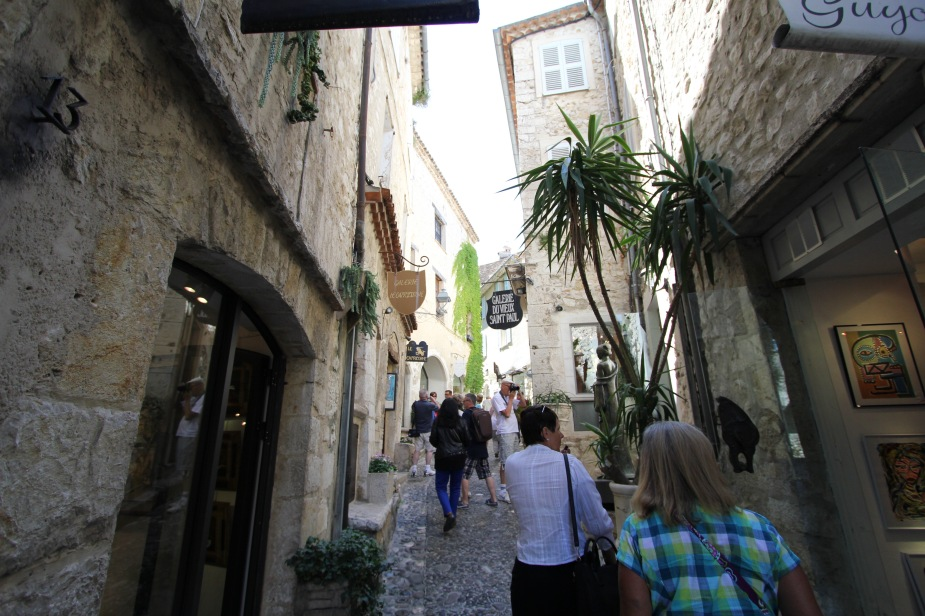 The village is lined with narrow, cobblestone streets with people still living in the homes and operating store fronts along the main walkways.