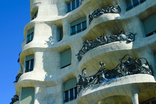 Also, Gaudi designed many buildings in Barcelona. This particular building is made to represent the love that Gaudi had for the theater. The balconies are actually masks that would be worn, which is easier to tell when stepping back from the building.