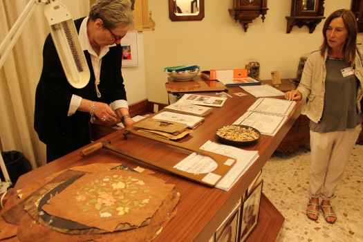 We had a demonstration of how inlaid wood art is made, which is very popular in this part of Italy. Here the artisan trims very small pieces of thin, colored wood to build the picture. Then, the pieces are assembled to form the picture being made....