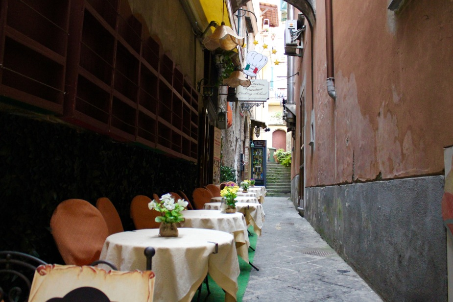 Walking the streets of Sorrento.  I love getting lost in small alleyways off the tourist paths....and, I find charming setups like this outdoor cafe waiting for the mid-day crowd.