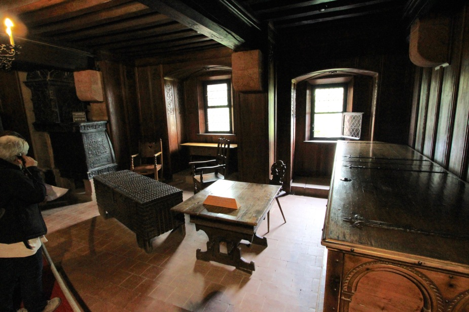 Inside one of the living spaces with replica, period furnishings.